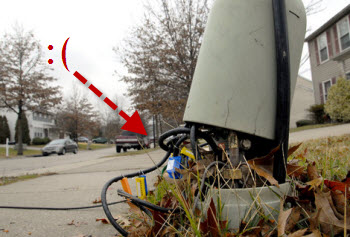 Comcast Installs Cable In Your Gutter, Across Your Driveway
