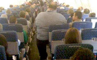 Passenger Of Size Allegedly Has Picture Taken By Flight Attendant