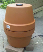 Make A DIY Meat Smoker Out Of Some Flower Pots