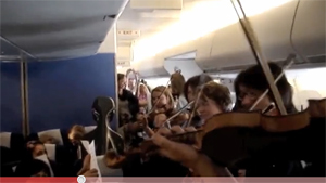 Stranded Orchestra Gives Impromptu Inflight Concert For Fellow Passengers