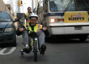 Guy Wins Race Against NYC Bus On Big Wheel