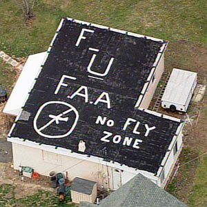 "Couple Paints ""FU FAA"" On Roof To Protest Jet Noise"