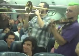 Delayed Air Canada Passengers Pass Time With Free In-Plane Concert