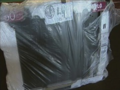 "Scammers Sell Plywood Wrapped In Black Tape As 50"" Flat Screen"