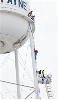 Comcast Installer Dangles From Water Tower For 1.5 Hours Before Rescue