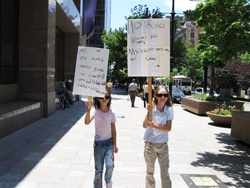 Angry Young Sisters Protest High Gas Prices After Losing Their Cable