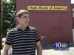 "After One Error Too Many Man Places ""I Hate Bank Of America"" Banner On His House"