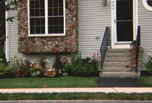 Condo Association Puts Lien On Woman's Townhouse Over Tiny Flower Garden