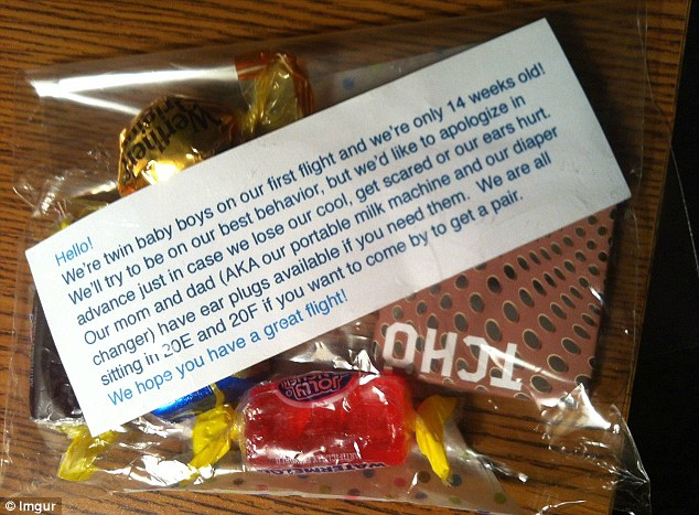 Parents Of Twin Tots Appease Fellow Travelers By Handing Out Bags Of Candy, Ear Plugs
