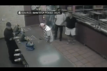 Security cameras show the the thief walking into the restaurant just as the customer realizes he is short $2,200.
