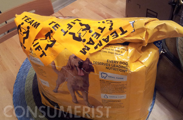 Stupid Shipping Gang Seals Dog Food Bag With Stickers, Hopes You Won't Notice