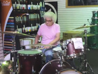 Mysterious Rockin' Grandma Awes Music Store Staff On Drums, Disappears
