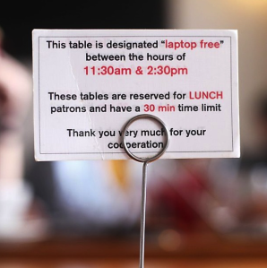 "Instagram user cadadj posted this image of the ""laptop free"" signs at Coffee Bar in San Francisco."