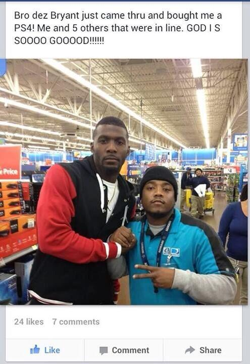 Dez posing for a photo with one of the lucky Walmart shoppers last night.