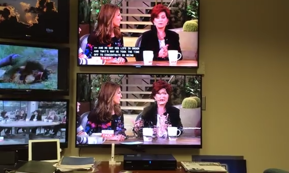 WRAL's demonstration of the problem. The top screen shows the over-the-air feed for the station. The bottom screen shows what happens when a Verizon customer gets a text message in the same room as the set-top box (see below for full clip).