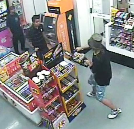 This is a screengrab from actual CCTV footage of the teen attempting to rob a 7-Eleven with a chainsaw and, yes, a flower-pot helmet.