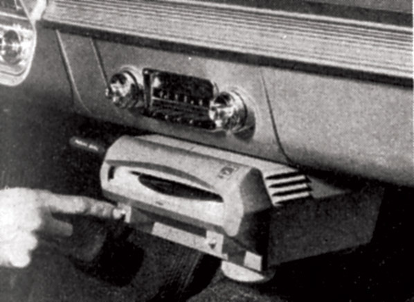 The Norelco Auto Mignon held one 45 RPM record and deserves a space in the Distracted Driving Hall of Shame.
