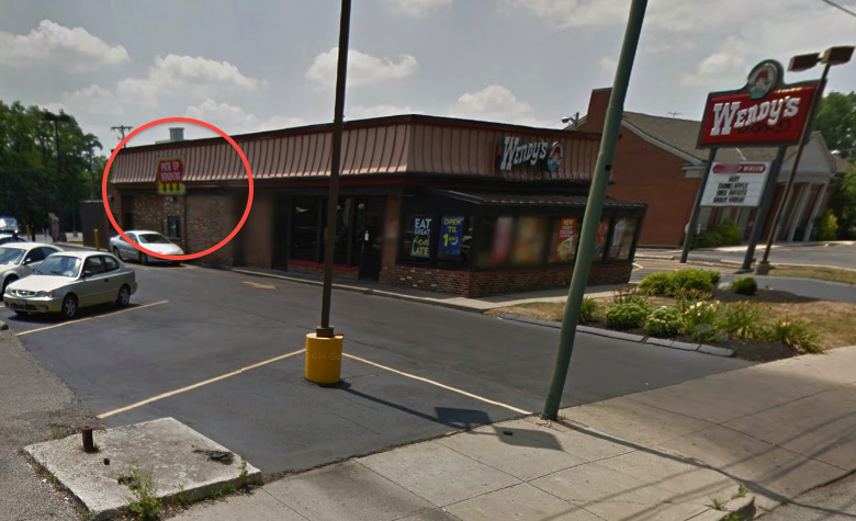 The employee was pulled through that wee window and then further assaulted by the customer. (Photo: Google Maps)