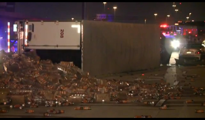 Tractor-Trailer Tips Over, Spills Beer Across Freeway