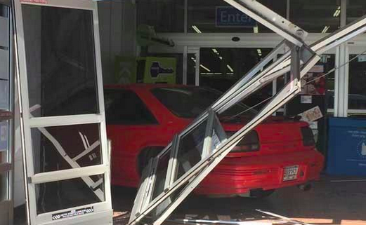 A former Walmart employee drove his car into the store's entrance. Photo courtesy of KPLC.