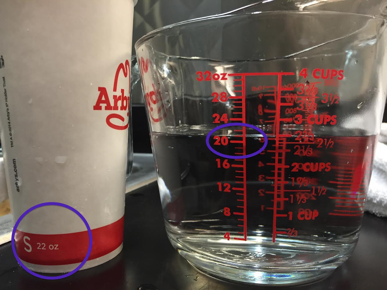 "Consumerist reader Michael noticed that his ""22 oz."" Arby's cup only holds 21 ounces of liquid. A quick look at the underside of the cup (see below) confirms that this cup can't possibly hold the amount of liquid advertised."