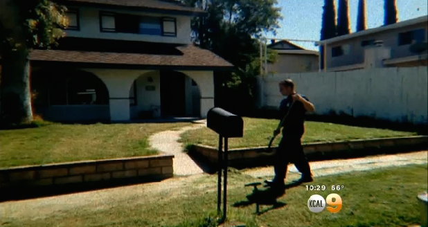FIrefighter tidying up cut grass like a boss. A nice boss. (CBS Los Angeles)