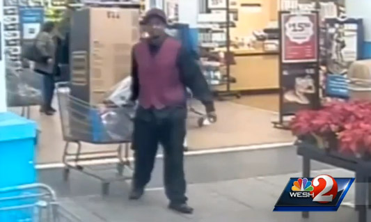 Anti-Santa takes his toy haul from the store while people tend to his alleged accomplice