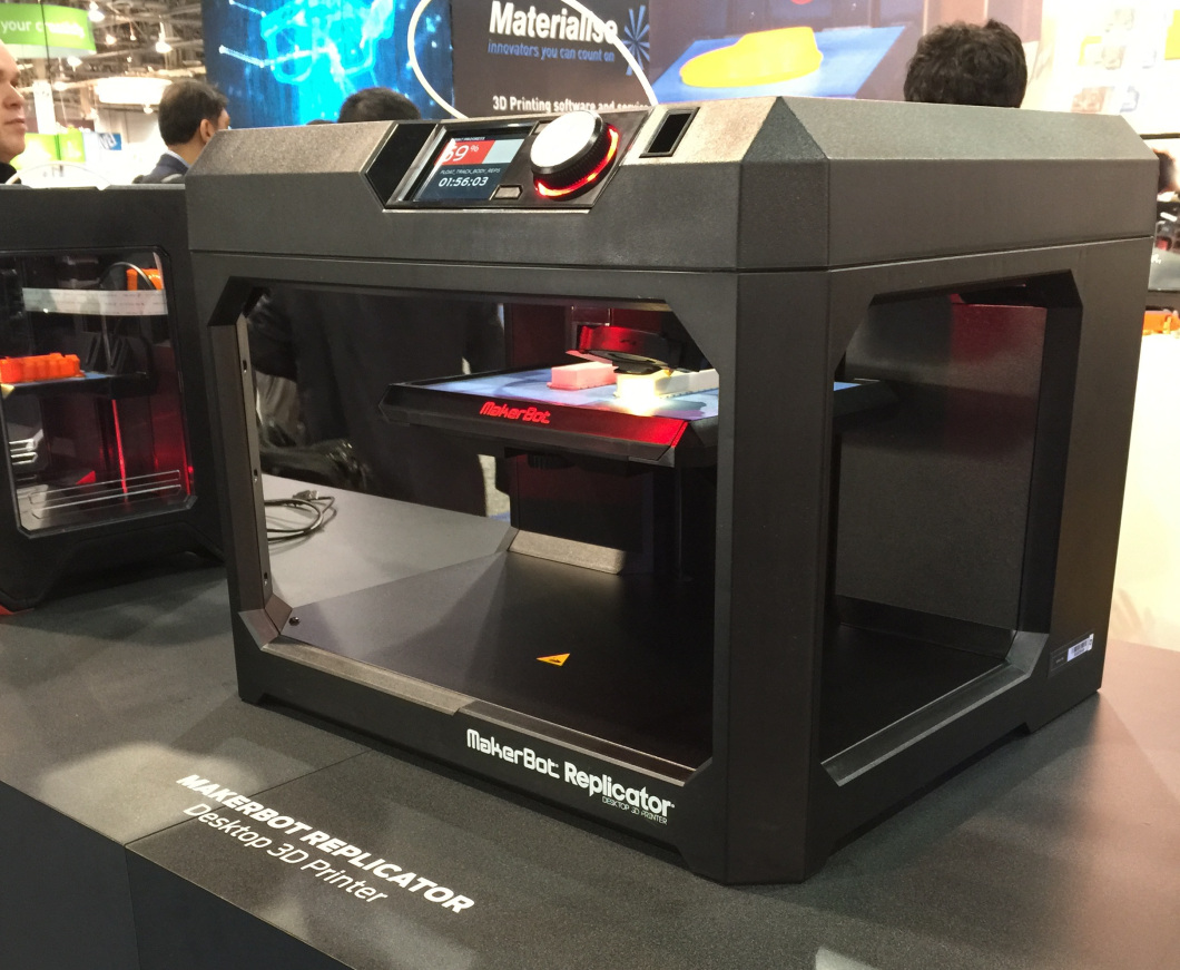 A desktop 3D printer on display at the MakerBot booth during the 2015 CES.