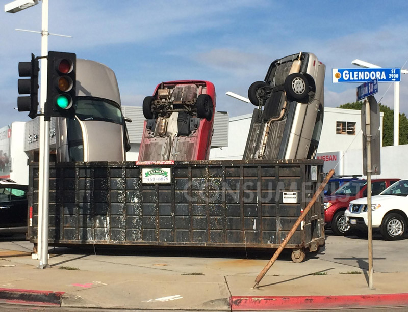 Yes, Those Are Real Cars Poking Out Of This Dumpster