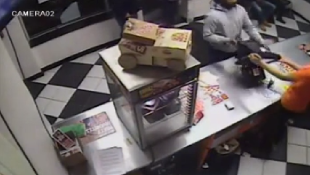 Watch Unhappy Little Caesars Customer Throw Register, Display Case At Employee