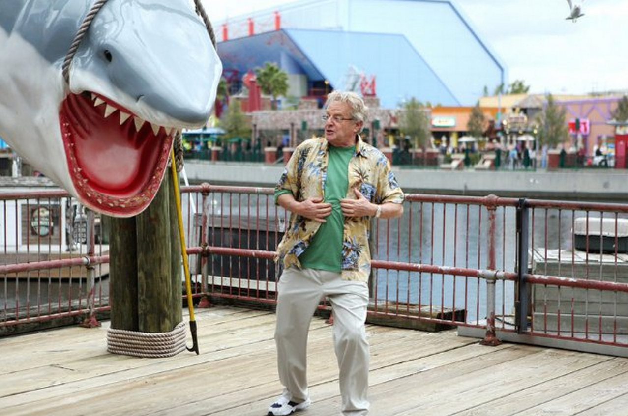 Comcast's Universal Studios park is the backdrop for Jerry Springer and other Comcast-tied celebs to cash in on what remains of the Sharknado craze.