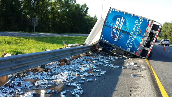 A semi full of Natural Light beer overturned Tuesday spilling its contents across a Florida highway.