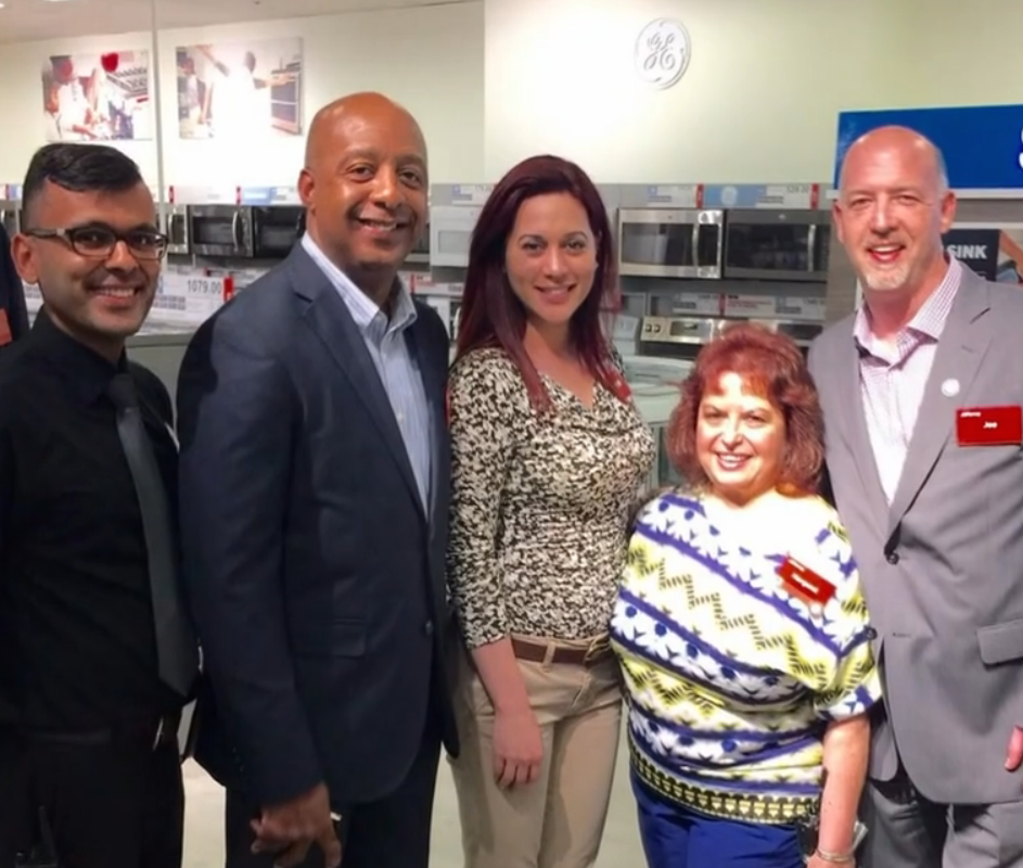 Spot the CEO: Marvin Ellison is second from left, posing with store employees.